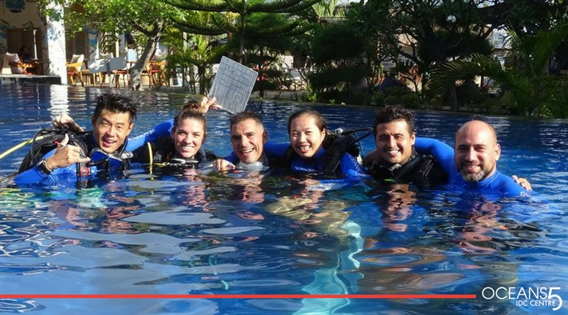 Group shot of the IDC candidates in the swimming pool