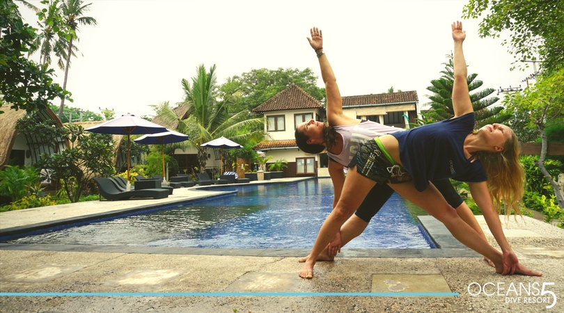 Yoga poses by the pool