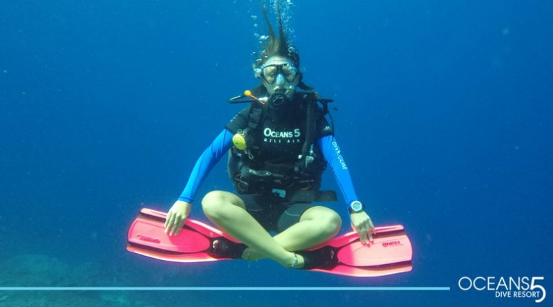 Diver hovering in meditation position.