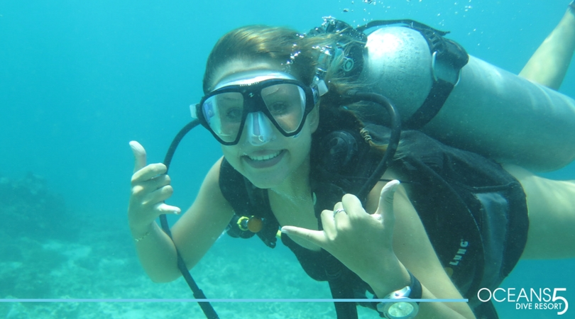 Happy divemaster diving